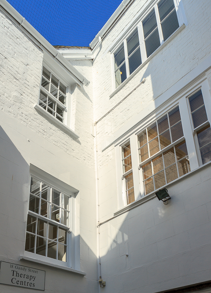Outside Courtyard, Gandy St., Exeter: Masonry Re-painting.